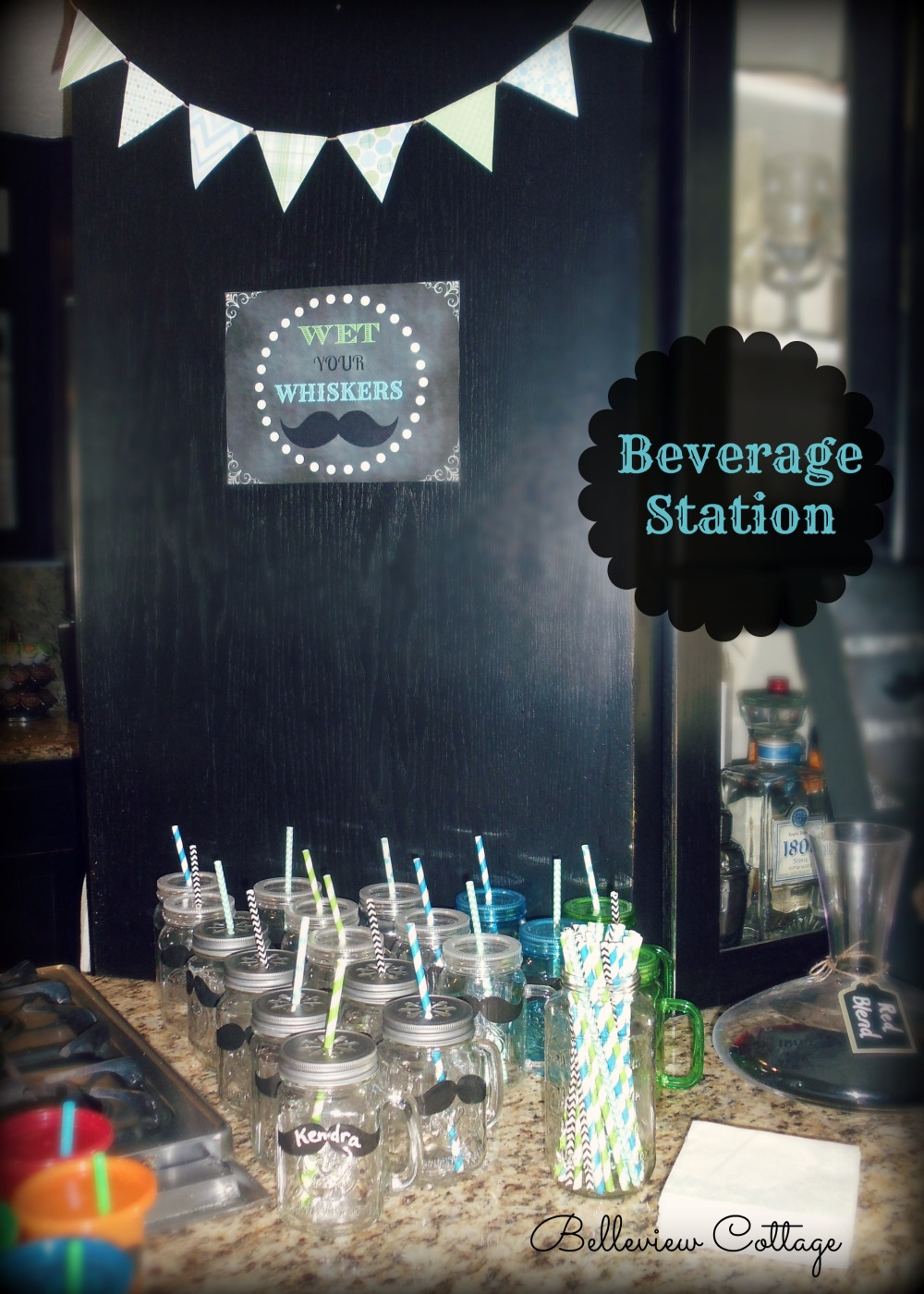 "Beverage Station: mason jars with daisy lids, paper straws, bunting, and ""Wet Your Whiskers"" sign 