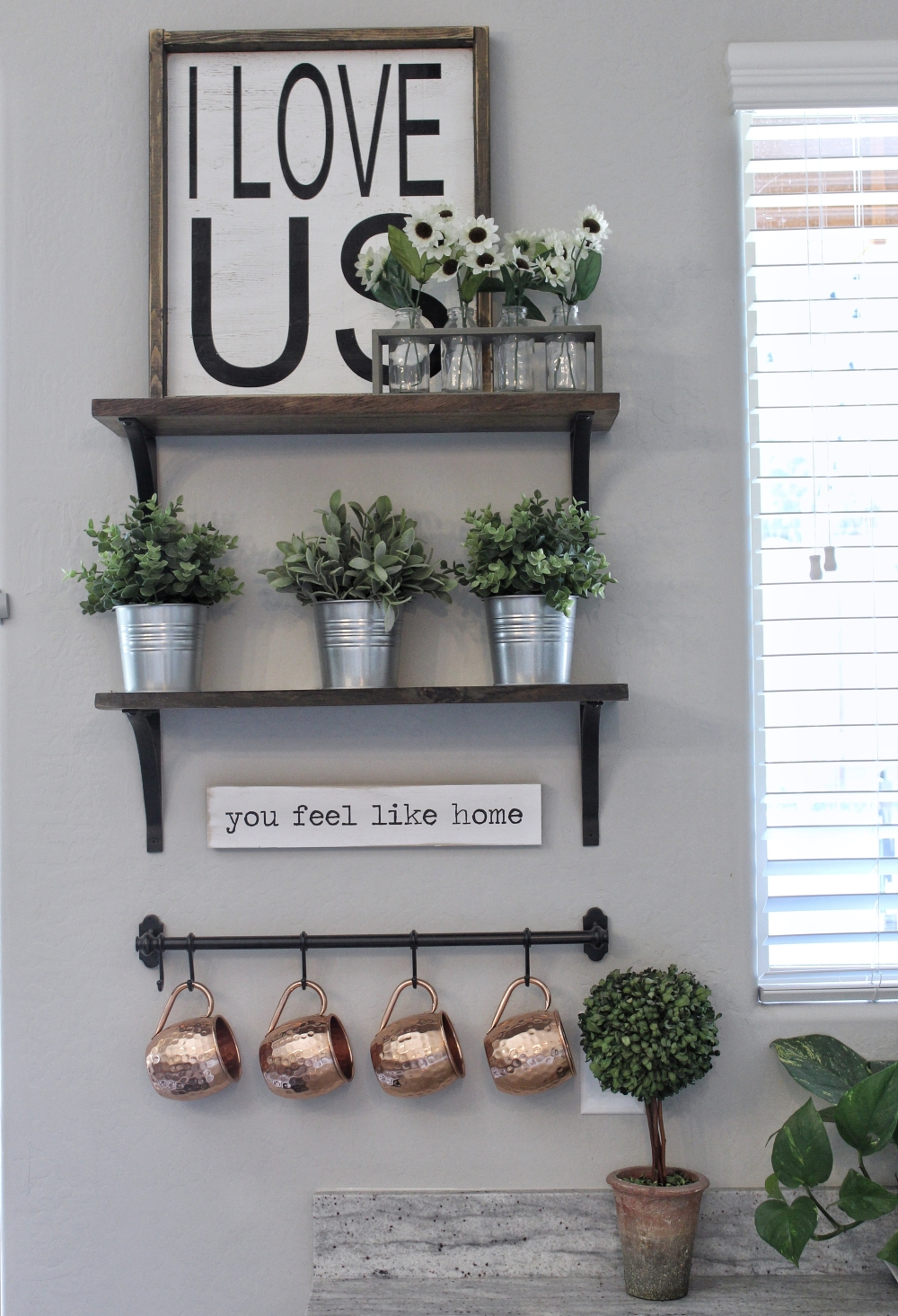 Modern Farmhouse shelf vignette with hand-painted signs. Copper Moscow Mule mugs.