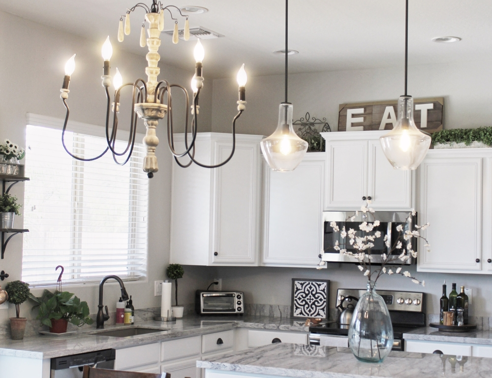 Farmhouse chandelier and edison bulb pendant lights. Sherwin Williams Repose Gray paint color.