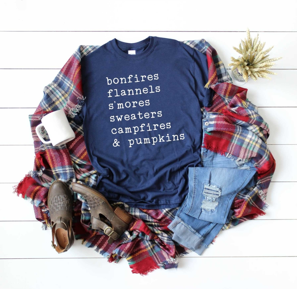 Fall graphic tee: bonfires, flannels, s'mores, sweaters, campfires & pumpkins. With cute plaid blanket scarf!