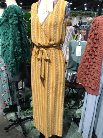 The tribal pattern on this jumpsuit looks awesome! And notice the wrap top... it was a HUGE trend at the show (keep reading for more on that)!